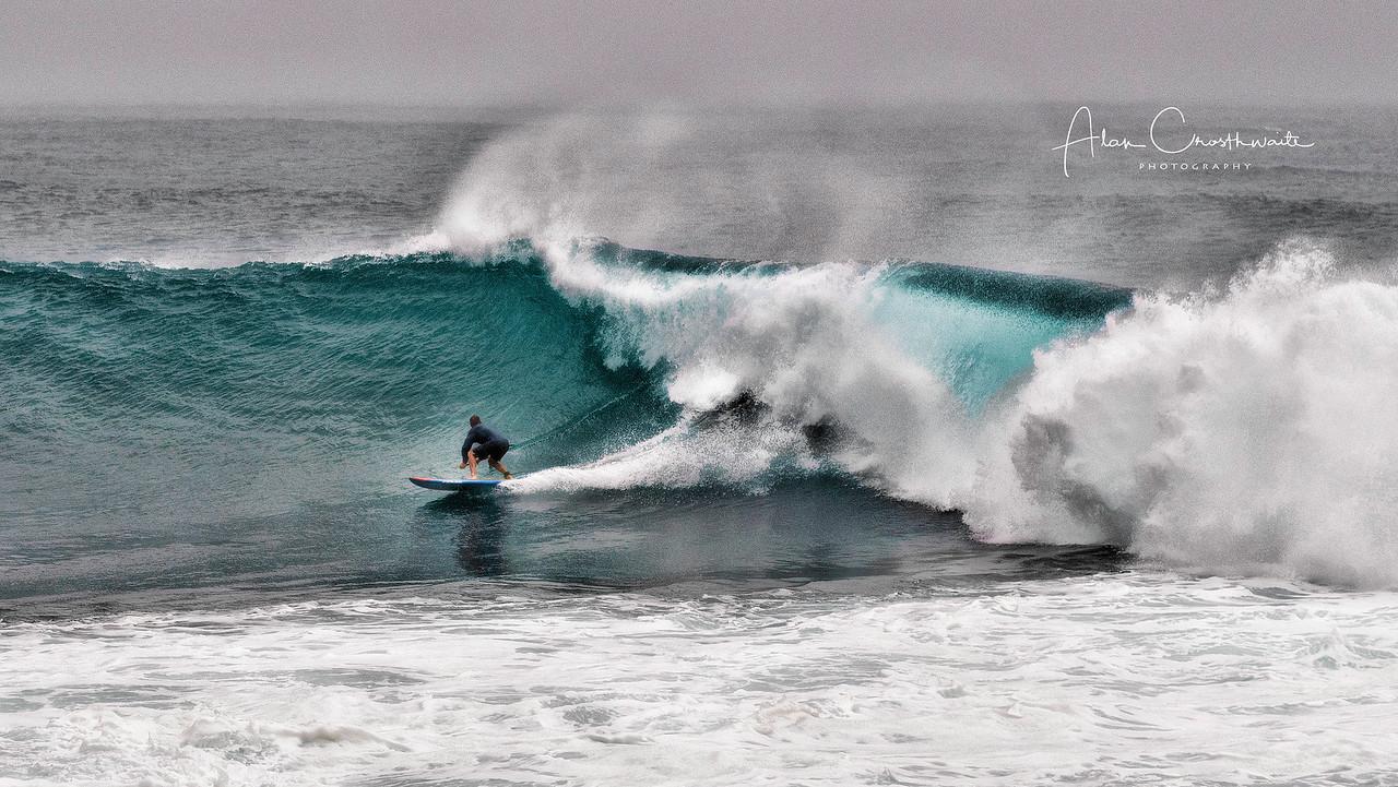 Riding big waves at Napili point.