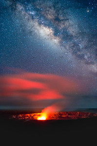 Kilauea with its glowing Halemaumau crater illuminating fog layer  brilliant Milky Way with shooting star at upper left.  Hawaii Volcanoes National Park, Hawaii.