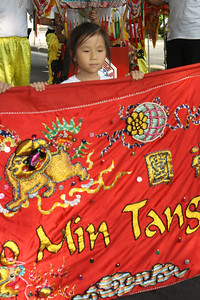 Young Girl Helps Carry a Banner