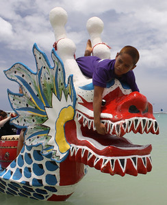 Break Time: Boy Climbs on Dragon Head