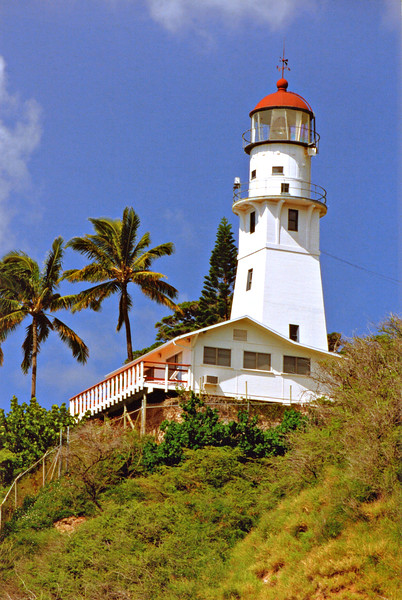John M. Kaukaliu was appointed keeper of Diamond Head Light at a salary of $75 monthly and the light was first exhibited on July 1, 1899.  Diamond Head Charlie and his daughter finally had a neighbor.  No keeper's home was built however and Kaukaliu had to live in a home a quarter mile from the light station.