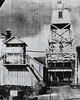 A picture from an old newspaper clipping showing the 1866 lighthouse on the left with its 2 lanterns above the storehouse, and the new 1905 skeleton tower.  You can also see the Pioneer Inn behind the 1905 light….