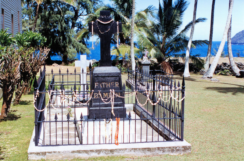 **Father Damien's grave at the church before his body was exhumed in 1936 and returned to Belgium**    The lighthouse was transferred to the National Park Service by the Coast Guard.