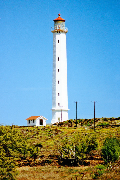 In 1908 Congress finally appropriated $60,000 to build a proper primary lighthouse on Moloka'i.   Construction began after several delays as access to the peninsula was controlled by the Department of Health.  All workers needed permits to both arrive and to leave Kalaupapa.  After a year the 132 foot octagonal concrete tower was completed.  James Keanu climbed the 189 iron stairs of the tower and lit the IOV lamp for the first time on September 1, 1909.