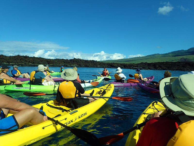 Hawaii, UnCruise Adventures, Kayakers with Tour Leader