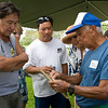 Sunao enlightens interested gardeners about grafting.