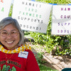Gladys answers questions at the Hawaii taro farmers table.