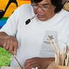 George Place demonstrates 'ohe kapala, bamboo stamps for decorating kapa.
