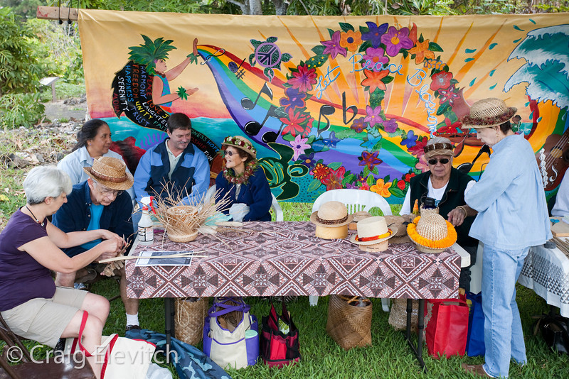 Weaver's table with banner by Konawaena High School students.