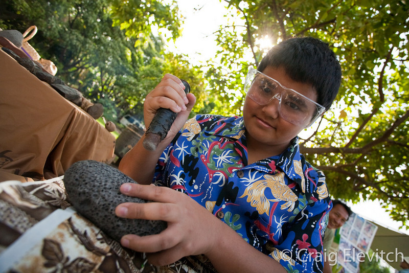 Young expert in pohaku shaping.