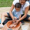 Keiki learn the poi pounding craft.