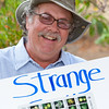 Ken Love indentifies strange fruit at the Hawai'i Tropical Fruit Growers table.