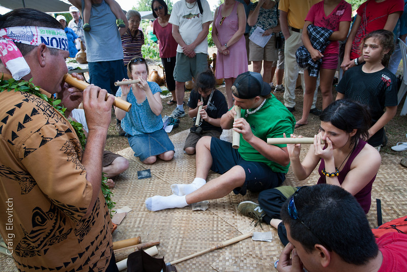 Ka'uhane Morton (on left) leads a workshop in making and playing the 'ohe hano ihu (traditional Hawaiian nose flute).