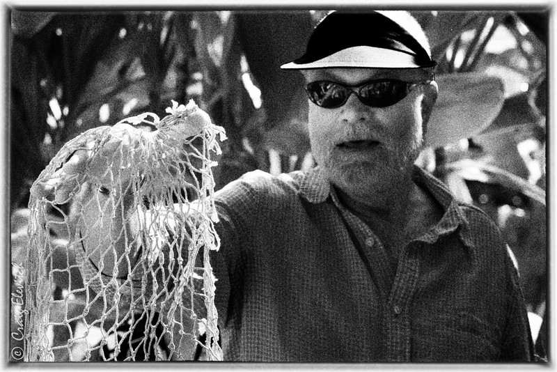 Bobby Camara displays a net woven from hau fiber during the garden tour he led.