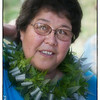 Roen Hufford displays a lei made from plants from her garden.