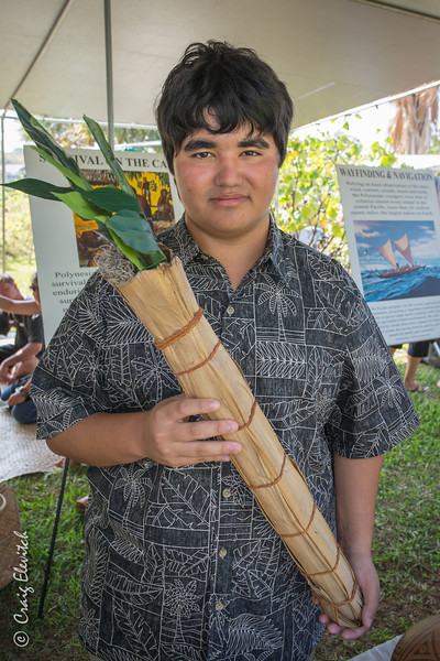 Kaipo Kalua'u displays a reproduction of a carrying shealth made of lauhala that voyaging Hawaiians used to transport live plants such as 'ulu across the ocean.