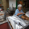 Auntie Shirley Kauhaihao prepares 'ulu for the poi pounders in the early morning.