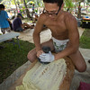 Kauhi Maunakea-Forth demonstrates the art of pounding 'ulu into pa'i 'ai (for poi).