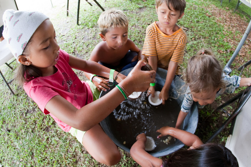 The kids love grinding coconut.