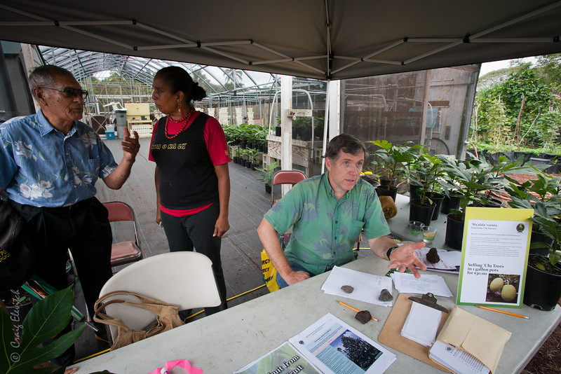 Chioki of Kua O Ka La and JB Friday of the University of Hawai'i offered advice on the planting and care of 'ulu trees at the tree sales tent.
