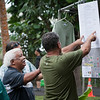 Uncle Keiki shows the festival schedule to enthusiastic visitors.