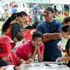 The keiki crafts area bustled with activity all day. Here Kaleo Kekipi (in blue) enjoys the scene.