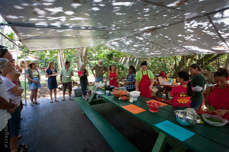 Auntie Mariposa (center) and her students (on right) teach various ways to cook 'ulu.