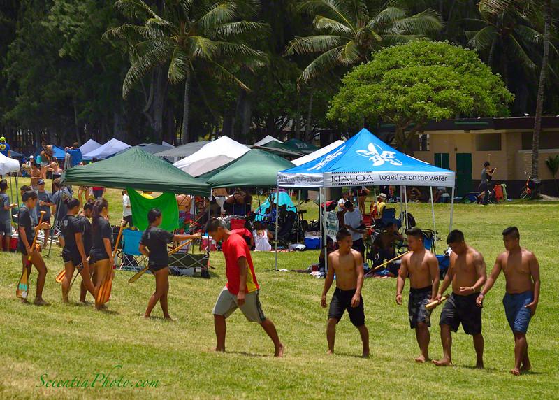 Boys & Girls, Each in Their Own World During the Outrigger Regatta at Kailua Beach Park