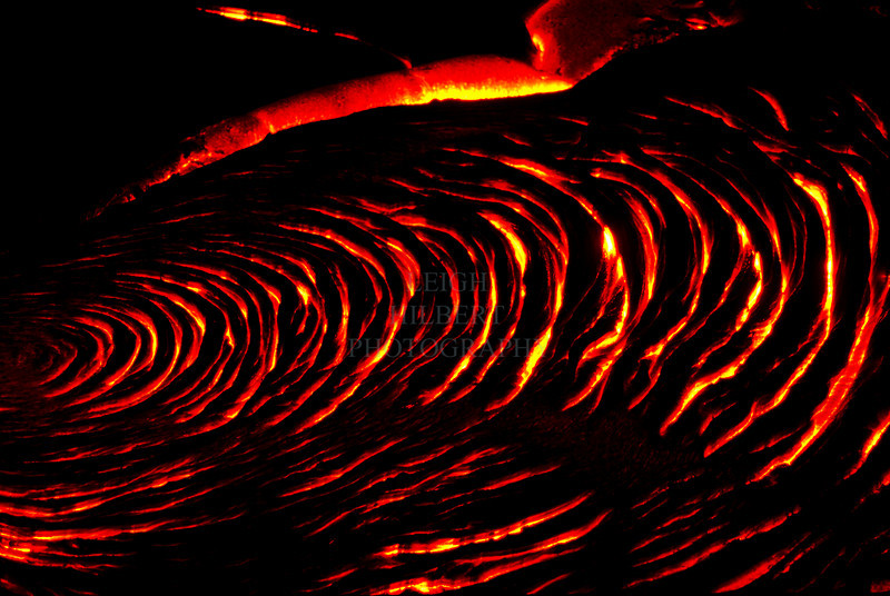 ~ Waves of Molten Lava ~<br /> <br /> Pahoehoe lava rolls and churns into wave-like bands as it spreads across older lava rock.<br /> <br /> Island of Hawaii