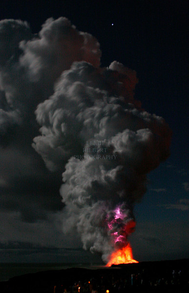 ~ Pele Powers ~<br /> <br /> A massive static electric lighting bolt flashes through the base of the plume (violet color above red-orange lava) where molten lava is pumping into the ocean on the Island of Hawaii.<br /> <br /> There is a crowd of people in the shadows below and that 'star' above is the planet Jupiter. The 3/4's full moon is just off to our left and the moonlight is what has illuminated the massive two-thousand foot tall lava plume.<br /> <br /> The plume is comprised of steam, sulfur dioxide, glass particles, ash, rock, and black sand. As the molten lava pours out of the lava tubes that carried it from the volcano above, it instantly explodes into black sand and rock fragments. Many of these molten chunks will continue floating and steaming on the ocean. <br /> <br /> Photo taken at 9:45 PM on July 14th, 2008 – Island of Hawaii