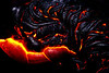 ~ Pele's Inner Essence Meets Atmosphere ~<br /> <br /> Pahoehoe 'rope' lava oozes and rolls into amazing shapes configurations. This one covers about eight-feet across. Taking photos this close is challenging for both the photographer and the camera because of intense heat from the molten lava. A light camera flash helps illuminate the raw iridescence of the slightly cooler dark lava.