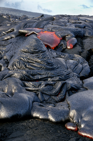 ~ Pahoehoe Molten Lava ~   <br /> <br /> This photo covers about 35 feet of actively oozing molten lava called pahoehoe (pah-ho-ay-ho-ay) in Hawaiian.<br /> In the distance is the volcano Pu`u O`o, the source of the lava.<br /> This lava flow is on the Big Island of Hawaii, 2004. These will be part of a larger lava series I am working on.