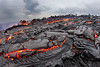 Vast lavascape of molten and inflating pahoehoe lava with a few surges of a1a in the background-- The day before this area was a standing old forest: Pele givith and Pele taketh away .... <br /> <br /> IMAGE# PALI_3040.jpg<br /> <br /> Date Taken:2011-12-05 09:29:56<br /> Camera:Canon EOS-1D Mark IV<br /> Exposure Time:2s (2/1)<br /> Aperture:f/16<br /> ISO:640<br /> Focal Length:15mm