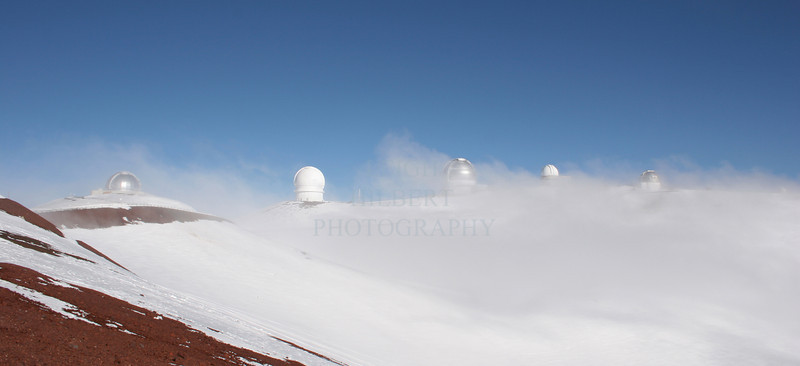 Observatories atop Mauna Kea volcano on the Island of Hawaii<br /> <br /> These are at the 13,700-foot elevation. There are thirteen main obseratories; considered the best viewing of the heavens in the world. They even seem to jut up into heaven here ;)<br /> <br /> (If purchasing a print, select no-crop to get a full framed print, which will require cropping off white-borders later)