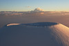 Pu`u Hau Kea -- Massive Volcanic Cinder Cone On the flanks of Mauna Kea Hawaii -- Snowboarders Delight: Local surfers Roy & Pete climb the cinder cone for the last ride down at sunset.