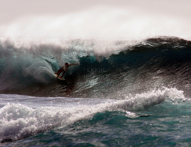 under a wave and still standing