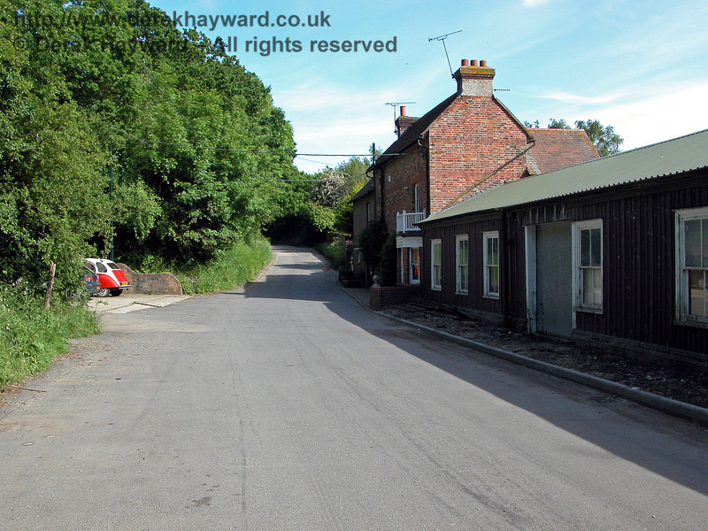 Cranbrook Station, looking east along the long lane that leads towards Hartley.  The old station buildings are on the right, having served as a pottery for a while after closure.  Beyond is the station house, which is now a private dwelling.<br /> Behind the camera is the former goods yard which contained two goods sheds and a coal depot.  This is now private extensive industrial premises, and there is no trace of the former trackbed.  When the station was open it used to be possible to obtain a panoramic view of the platform area from Hill Farm Bridge, but this is now totally obscured by vegetation.  31.05.2004