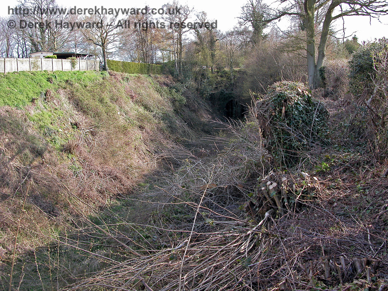 The northern portal of Horsmonden Tunnel, pictured after works were undertaken to clear scrub from the cutting.  The southern end of this tunnel has been almost totally infilled and the tunnel and cutting are a dangerous environment.  12.04.2004