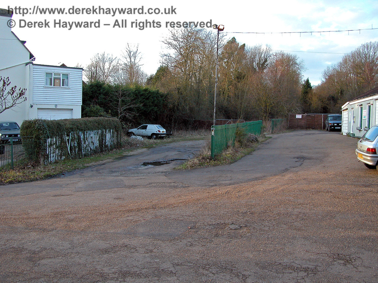 Looking north west, the left hand drive led to the goods yard (now infilled) and the right hand drive to the station.