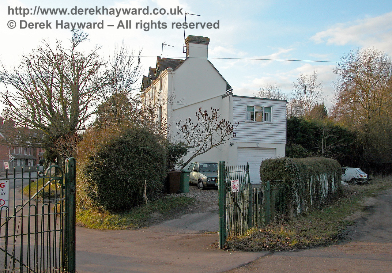 The side of the former Station Master's house at Horsmonden, with the original station gates in the foreground.  It is unlikely that the South Eastern Railway included a garage in the original design!  17.02.2006