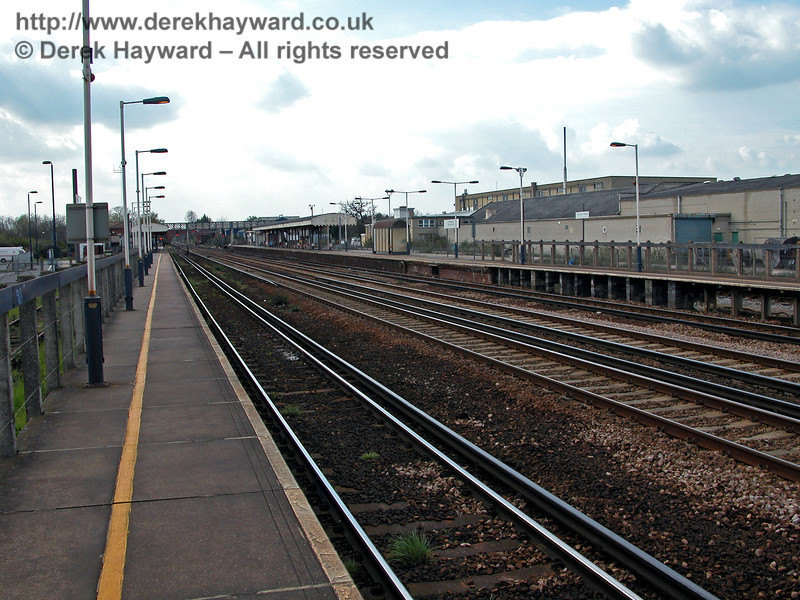Looking west at Paddock Wood station from platform level.  A bay platform is provided for terminating Maidstone line trains behind the platform on the right.  The platform has been extended for longer main line trains, but only to half the available width.  Much shorter Maidstone trains fit the existing bay.  12.04.2004