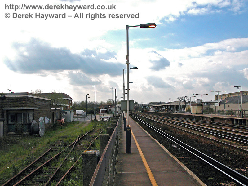 Looking west from the end of Paddock Wood Station.  On the left, behind the fence, is the remains of the disused track that led to the bay platform used by Hawkhurst Branch Line trains.  12.04.2004