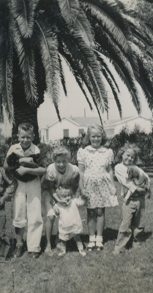 Tom holding Sambo, Gloria Goodwater with her little sister, Carol Cotton and Margie at 11832 Grevillea Avenue Hawthorne California