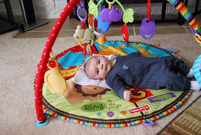 playing on playmat that Grandpa Lemke got him