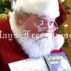 Santa arrives at Kyle Library to read the Night Before Christmas, with John Hahn as Santa