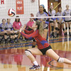 Hays High senior Kathryn Wristen takes to the floor to save the ball during the 2014 Rebel Bash. Under first year head coach Stephanie Coates, Hays fought for a playoff spot, but was unsuccessful, missing the postseason for the first time since 2000. (Photo by Cyndy Slovak-Barton)