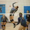 Lehman Lady Lobo senior Angel Cruz goes up to make a play during a match against the Akins Lady Eagles in September. (Photo by Rafael Marquez)