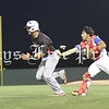 Hays Rebel catcher JC Cerda tracks down and tags out a Victoria East Titan baserunner on the third base line in game one of the best of three regional quarterfinal series in May. (Photo by CYNDY SLOVAK-BARTON)