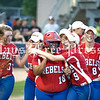 Hays High shortstop Maddy Shannon (9) embraces designated player Michele Pesina (18) after Pesina's solo home run against the Medina Valley Lady Panthers on May 23. (Photo by Rafael Marquez)