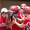 Hays High sophomore Karina Rocha is mobbed by teammates after smashing a grand slam in the UIL Class 4A regional quarterfinal playoffs against the Dripping Springs Tigers in April. (PHOTO BY RAFAEL MARQUEZ)